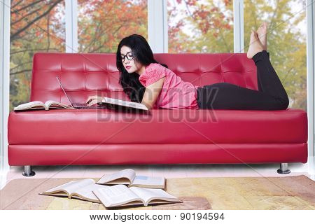 Student Studying On Sofa At Home
