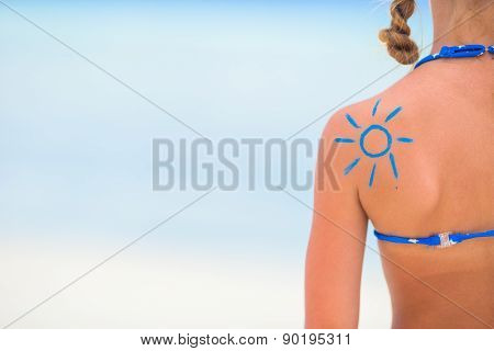Close up sun painted by sun cream on kid shoulder