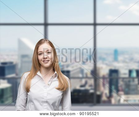 Young Beautiful Business Lady Is Smiling In The Panoramic Glass Office. New York Background. A Conce