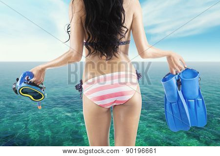 Woman With Flippers And Mask At Coast