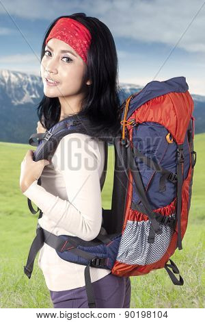 Young Hiker With Backpack In Nature