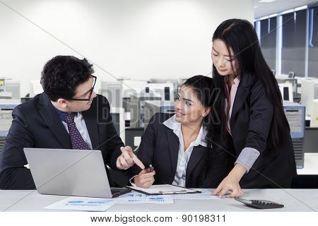 Young Manager Talking With His Workers