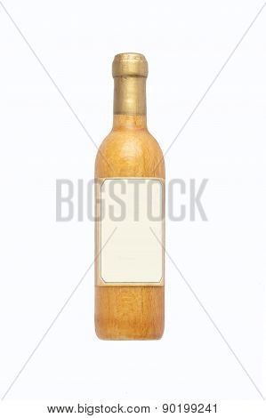 Wooden Wine Bottle And Blank Label, Isolated On White Background.