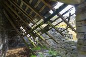 foto of derelict  - Derelict stone building collapsing roof Snowdonia Wales United Kingdom - JPG