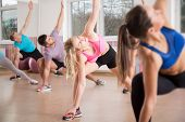 foto of stretch  - Fitness group stretching body during fitness classes - JPG