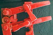 image of fragmentation  - Abstract industrial details fragment old grungy red lock mechanism - JPG