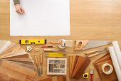 stock photo of baseboard  - Man sketching a DIY project on a work table with construction tools top view hobby and crafts concept - JPG