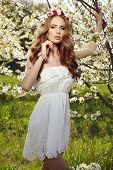stock photo of headband  - fashion outdoor photo of beautiful sensual woman with long red hair and flower - JPG