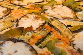 image of zucchini  - A closeup to vegetarian pizza toppings - JPG