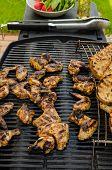 foto of braai  - Teriyaki chicken wings with garlic bread and herbs - JPG