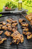 stock photo of braai  - Teriyaki chicken wings with garlic bread and herbs - JPG