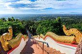 image of balustrade  - Golden Naka statue on staircase balustrade at Wat Phra That Doi Kham - JPG