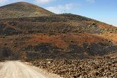 picture of canary-islands  - a road on wild volcanic landscape at Lanzarote Island Canary Islands Spain - JPG