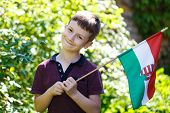 foto of hungarian  - Little boy with hungarian flag outdoor portrait - JPG