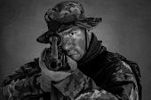 stock photo of m4  - Soldier in camouflage and modern weapon M4 on black background - JPG