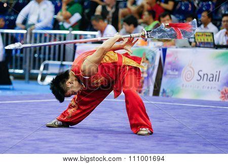 JAKARTA, INDONESIA - NOVEMBER 15, 2015: Marcelo Yamada of Brazil performs the movements in the men's Dadao event at the 13th World Wushu Championship 2015 held at Istora Senayan, Jakarta.