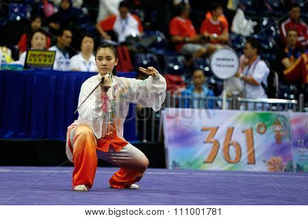 JAKARTA, INDONESIA - NOVEMBER 15, 2015: Chan Lu Yi of Malaysia performs the movements in the women's Taijijian event at the 13th World Wushu Championship 2015 held at Istora Senayan, Jakarta.