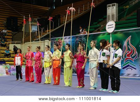 JAKARTA, INDONESIA - NOVEMBER 15, 2015: Participants of the women's Qiangshu event begins the competition with a parade at the 13th World Wushu Championship 2015 held in Istora Senayan, Jakarta.