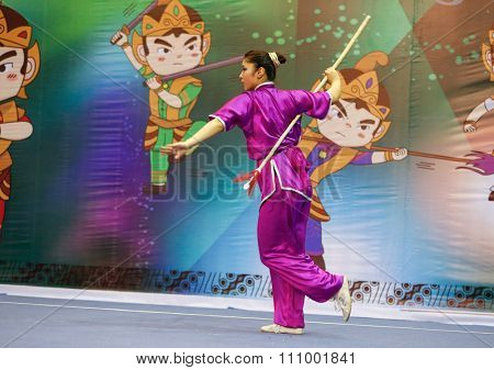 JAKARTA, INDONESIA - NOVEMBER 15, 2015: Ayaka Honda of Japan performs the movements in the women's Qiangshu (spear) event at the 13th World Wushu Championship 2015 held in Istora Senayan, Jakarta.