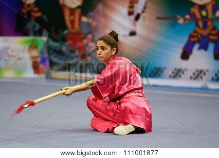 JAKARTA, INDONESIA - NOVEMBER 15, 2015: Patricia Nseir of Lebanon performs the movements in the women's Qiangshu (spear) event at the 13th World Wushu Championship 2015 held in Istora Senayan, Jakarta