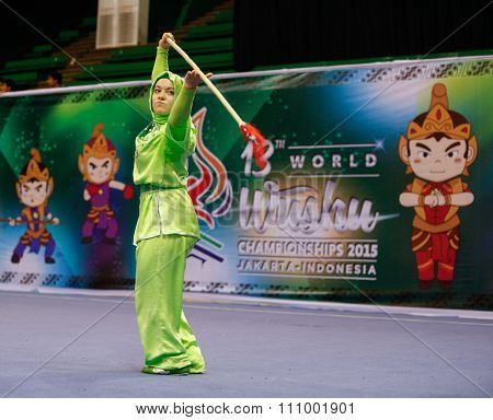 JAKARTA, INDONESIA - NOVEMBER 15, 2015: Elif Akyuz of Turkey performs the movements in the women's Qiangshu (spear) event at the 13th World Wushu Championship 2015 held in Istora Senayan, Jakarta.