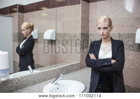 Beautiful Model Woman Businesswoman In Business Attire In The Mirror