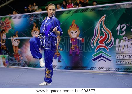 JAKARTA, INDONESIA - NOVEMBER 15, 2015: Diana Traize of Kazakhstan performs the movements in the women's Shuangjian event at the 13th World Wushu Championship 2015 held in Istora Senayan, Jakarta.