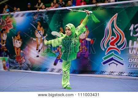 JAKARTA, INDONESIA - NOVEMBER 15, 2015: Elif Akyuz of Turkey performs the movements in the women's Shuangjian event at the 13th World Wushu Championship 2015 held in Istora Senayan, Jakarta.