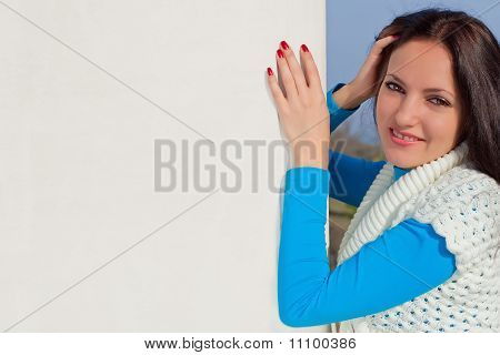 Beautiful sexy girl holding a blank billboard
