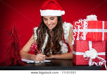 Santa Girl Making List Of Christmas Present Wishes