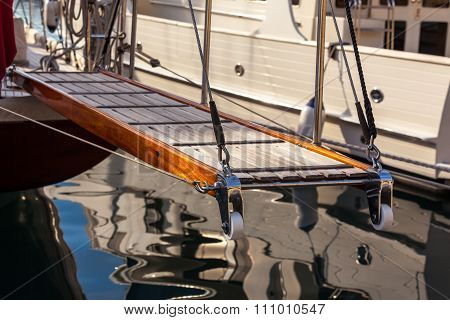 Wooden Ladder On Marine Yacht Staying In Port