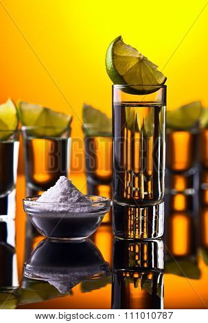 Gold Tequila On A Black Reflective Background