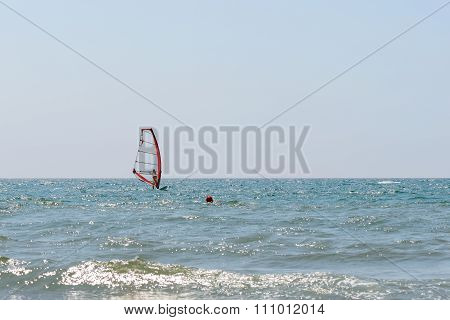 Windsurfer And Boat