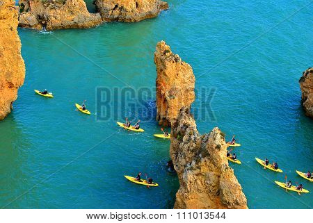 Tourists kayaking through the spectacular rock formations