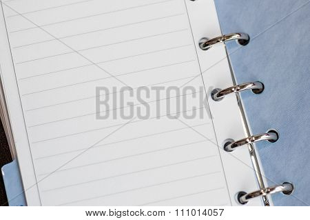 Note paper in clipped book