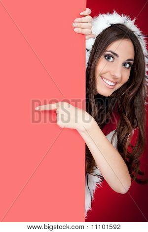 Santa Girl  Behind Blank Board Pointing