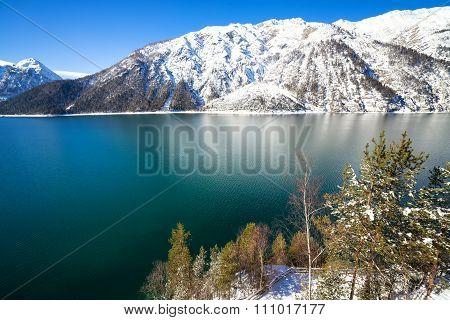 Mountain lake winter landscape. Achensee Tirol Austria.