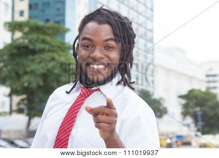Happy African American Businessman With Dreadlocks In The City