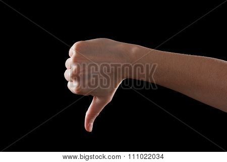 Thumb Down Male Hand Sign Isolated On A Black