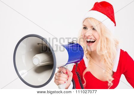 Funny amusing blonde woman in santa claus costume and hat talking in speaker over white background