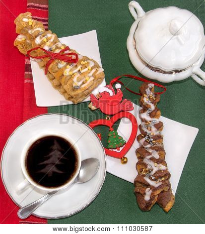 Cup Of Steaming Coffee And Croissants Baked In The Shape Of Christmas Tree.