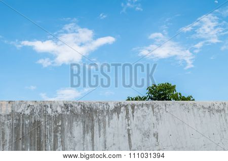 Dirty Concrete Wall With Beautiful Blue Sky At The Midday Background