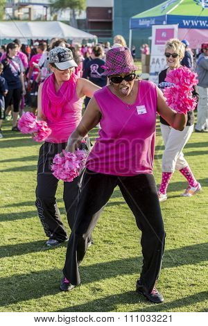 Women Dancing At Breast Cancer Awareness Event