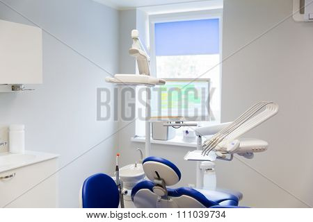 medicine, stomatology, dentistry and health care concept - dental clinic office with medical equipment