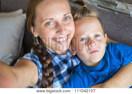 Mother And Son Posing For Selfie