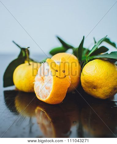 Tangerines With Leaves On A Wooden Table. Shaped Cochlea