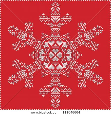 Scandinavian Nordic winter cross stitching, knitting  Christmas pattern in  in red snowflake shape