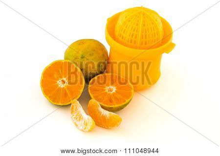 Juice Extractor With Oranges Isolated On White Background