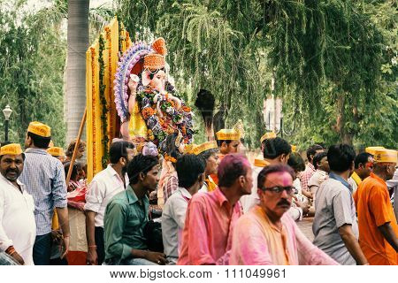 People carrying Hindu God Idol.