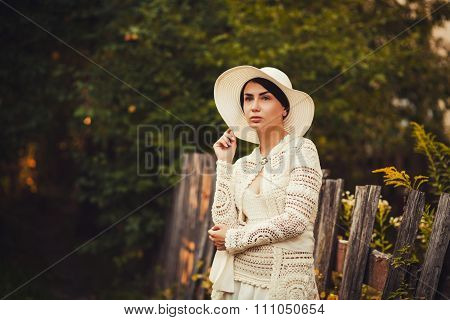 Romantic Lady In A Hat And Dress